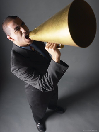 Angry-businessman-yelling-into-bullhorn